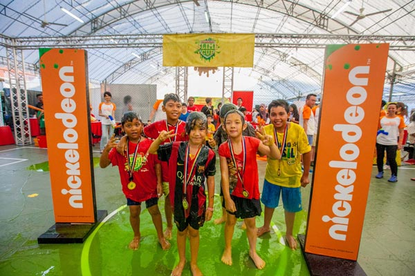 Six of the Soccer Showdown winners smiling after getting slimed at the Closing Ceremony of Nickelodeon Slime Cup 2015