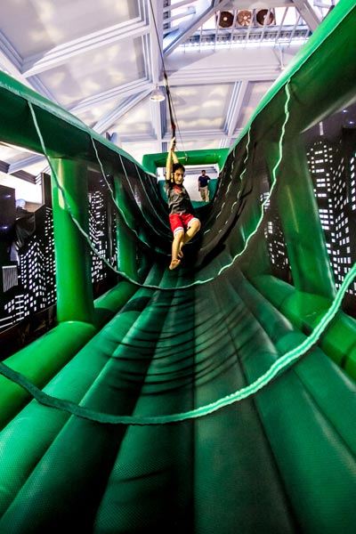 Sliding through the Ninja Zipline station at Teenage Mutant Ninja Turtles Dojo Experience event at Downtown East with Nickelodeon