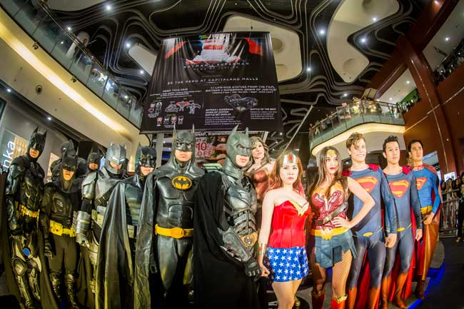 Batman, Wonder Woman and Superman fans gather for a picture after the unveiling of the 1:1 life-size figurines