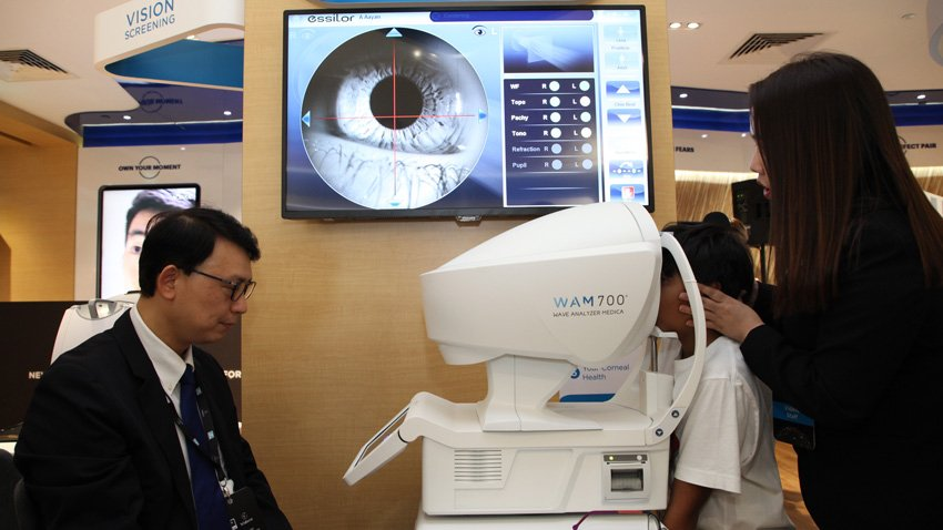 A-child-taking-an-eye-examination-with-WAM700plus,-state-of-the-art-instrument-by-Essilor