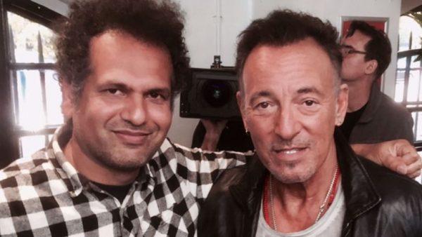 Sarfraz Mansoor with Bruce Springsteen.