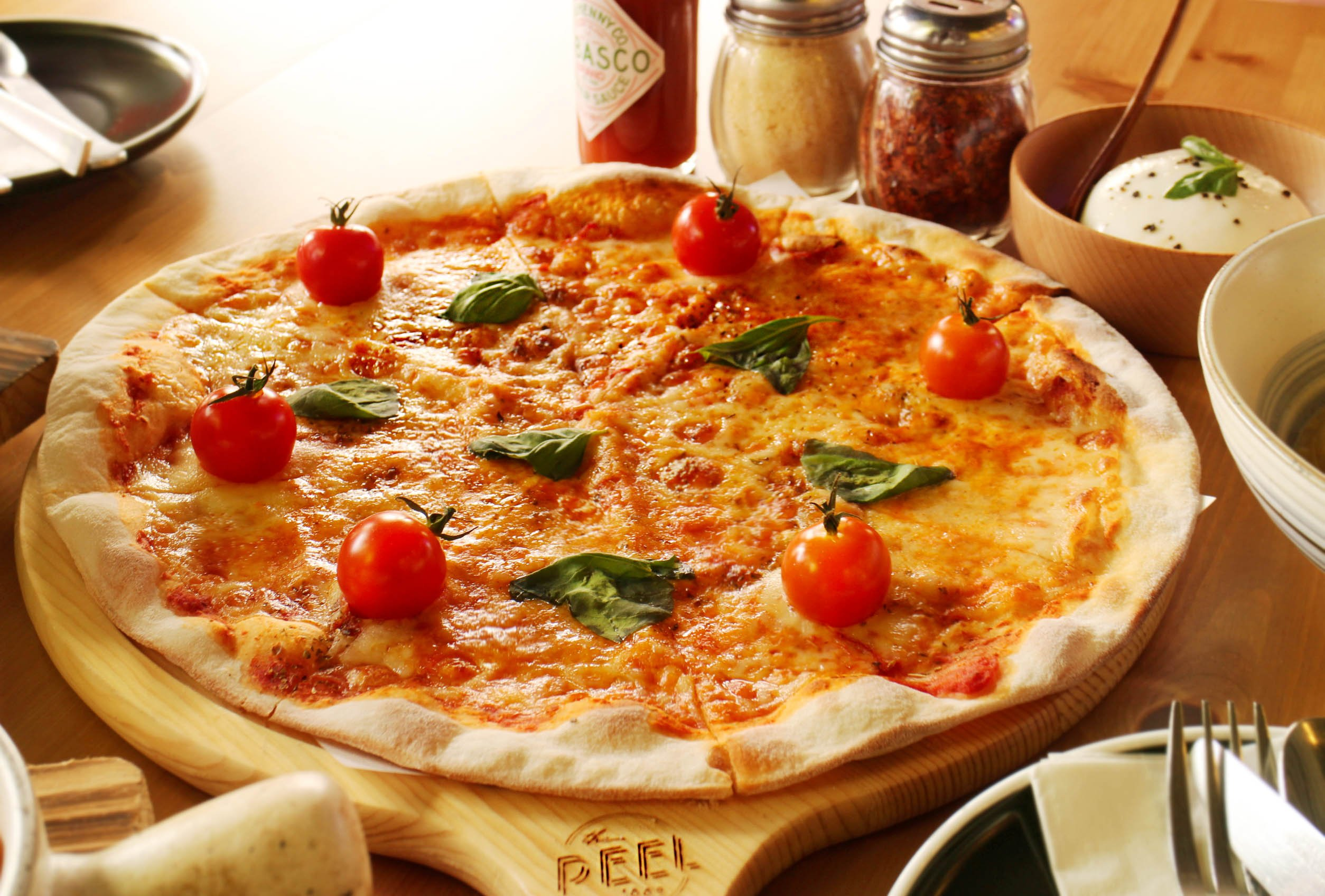 The Margherita at The Peel is served with a generous ball of Burrata cheese, found at MyVillage.